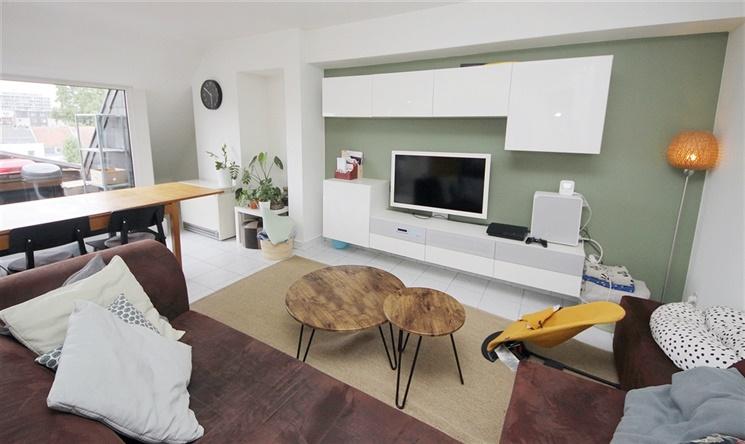Lichtrijk duplex-appartement met uniek zicht over de Coupure!